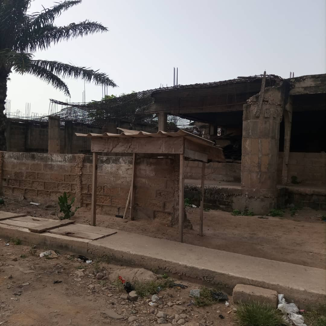TITLED PLOT WITH UNROOFED HOUSE AT MAMPROBI